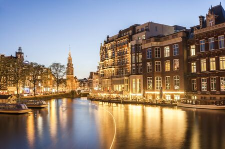 amstel river: Bright cityscape with night lights reflection in water, architecture of Amsterdam, Holland