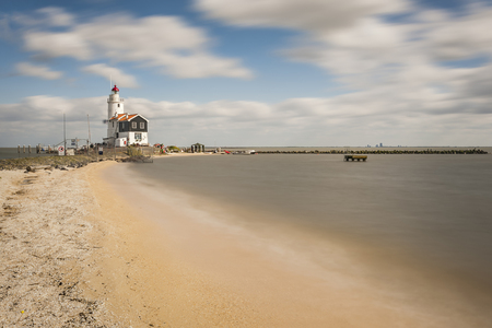 markermeer: Landscape with lighthouse on seashore, dramatic seascape, long exposure