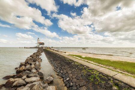 markermeer: Landscape with lighthouse on seashore, dramatic seascape