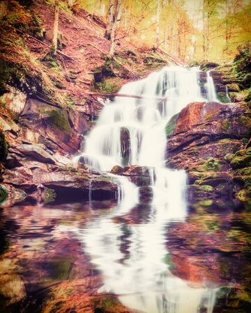 vintagel: Vintagel autmn landscape with waterfall reflection in lake