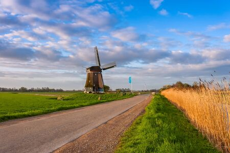 holland landscape: Road and windmill, traditional Holland landscape