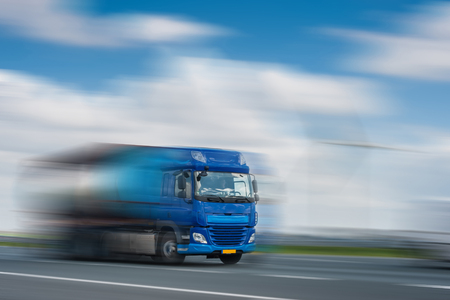 Blue track in motion blur on highway, fast delivery anywhere in the world