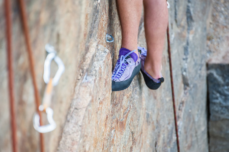 Rock climber preparing for climbing, feet close-up