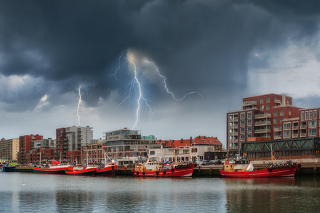 Landscape with ships at pier and lightning, stormy weather, Den Haag, Netherlands
