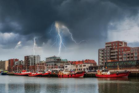 den: Landscape with ships at pier and lightning, stormy weather, Den Haag, Netherlands