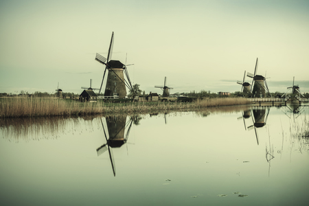 Traditional vintage Holland landscape with windmills and canals, Kinderdijk. Lomography style