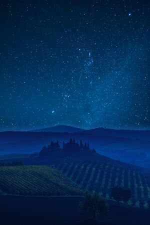 Night landscape with Tuscany valley and beautiful stars in sky Фото со стока - 71983341
