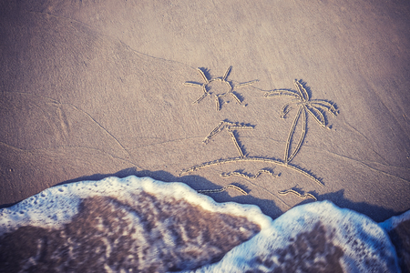 Vintage vacation background with drawing on sand and wave