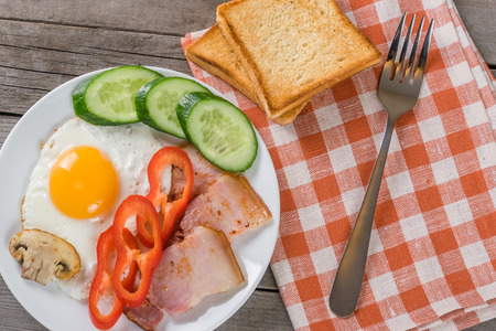 Fried eggs, bacon and toastes - your breakfast