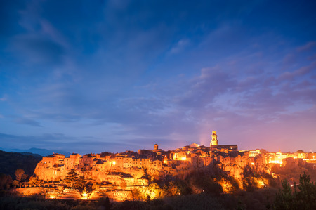 The ancient Etruscan town of Pitigliano at night in light of lanterns, landscape, Tuscany, Itali