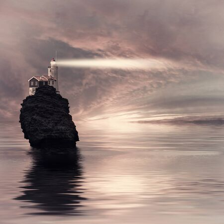 Evening vintage landscape with lighthouse on seashore, a ray of light in twilight for navigators, dramatic seascape. Film flter