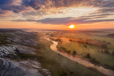 Landscape on sunrise with fog, river and chalky hills, make from drone, aerial view