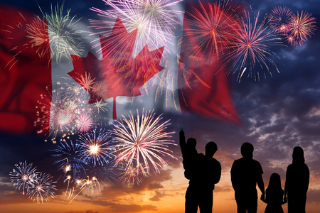 People looks holiday fireworks on independence day, flag of Canada in sky, background and banner