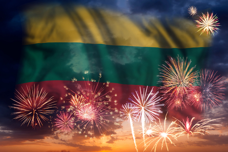 Holiday sky with fireworks and flag of Lithuania, independence day