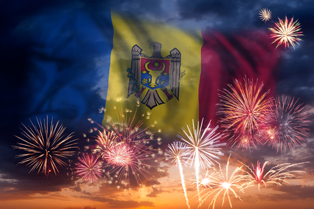 Holiday sky with fireworks and flag of Moldova, independence day