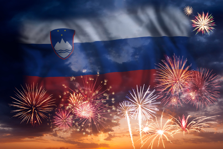 Holiday sky with fireworks and flag of Slovenia, independence day