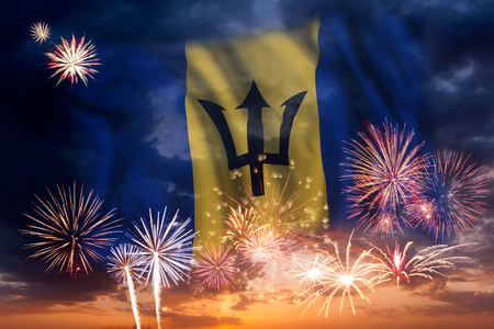 Holiday sky with fireworks and flag of Barbados, independence day