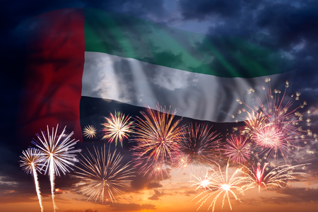 Holiday sky with fireworks and flag of United Arab Emirates, independence day