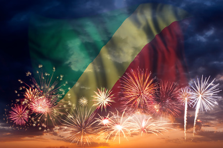 Holiday sky with fireworks and flag of Republic of the Congo, independence day Stock Photo