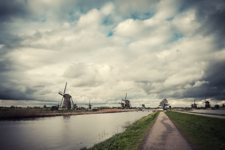 Traditional landscape with windmills, Kinderdijk, Netherlands. Retro stylization, film filter 版權商用圖片