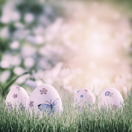 Easter holiday background with painted eggs and floral decoration. Place for your text, copy space. Vintag stylization, retro film filter