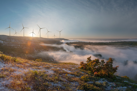 Industrial landscape with wind turbines on hills, renewable eco energy, electric windmills