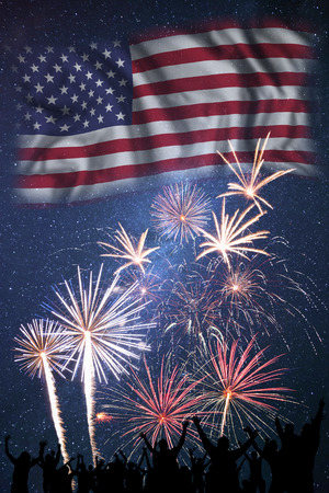 People looks holiday fireworks on independence day of America, flag in sky Stock Photo