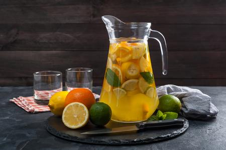 Homemade lemonade with mint from lemone and orange, citrus refreshig beverage in glass