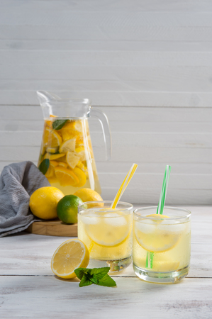 Homemade lemonade with mint from lemone and orange, citrus refreshig beverage in glass