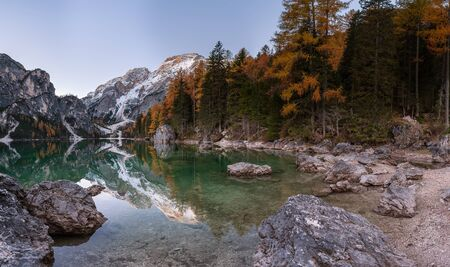 Morning landscape with lake and mountain. Peak reflection in calm water lago di Braies, Italy