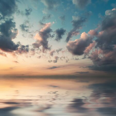 Beautiful nature background - majestic sky with clouds reflection in water. Retro stylization, vintage film filter