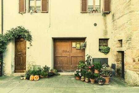 Beautiful quiet streets of ancient European city, Pienza, Italy. Retro stylization, vintage film filter
