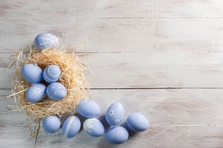 Easter painted eggs on wooden rustic table, holiday background for your decoration Stock Photo - 130555485