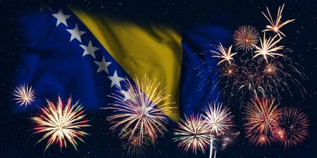 Holiday sky with fireworks and flag of Bosnia & Herzegovina, independence day of country