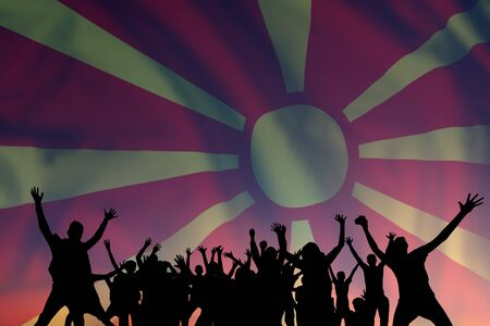 Peoples silhouette on flag and sky background, day of Macedonia, independence holiday Фото со стока