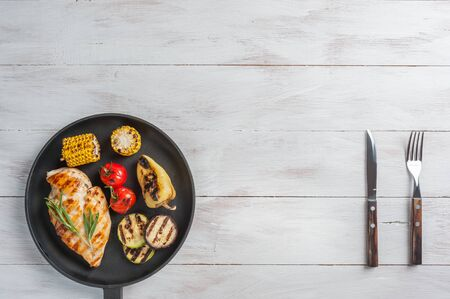Chicken fried fillet and grilled vegetables, delicious barbecue dinner, flat lay food background Фото со стока