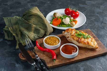 Fried chicken fillet and boiled vegetables, delicious barbecue dinner, flat lay food background