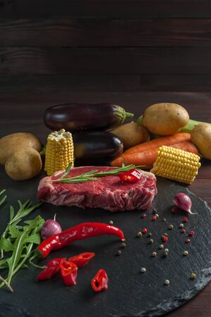 Beef steaks rib eye ready to cooking, culinary background. Fresh raw meat on wooden cutting board with rosemary, selective focus Фото со стока