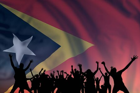Peoples silhouette on flag and sky background, day of East Timor, independence holiday