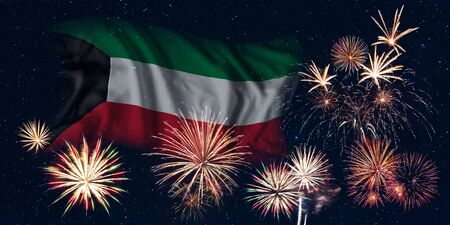 Holiday sky with fireworks and flag of Kuwait, independence day of country Фото со стока