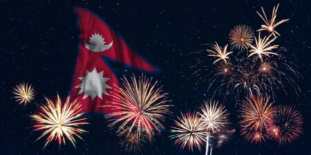 Holiday sky with fireworks and flag of Nepal, independence day of country Фото со стока