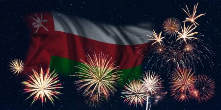 Holiday sky with fireworks and flag of Oman, independence day of country Фото со стока