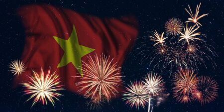 Holiday sky with fireworks and flag of Vietnam, independence day of country