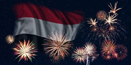 Holiday sky with fireworks and flag of Yemen, independence day of country Фото со стока