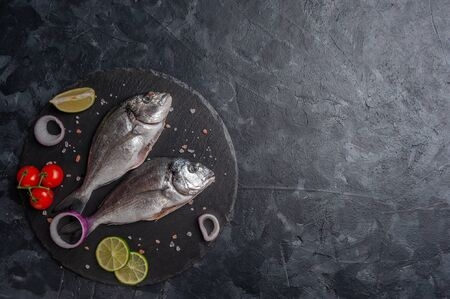 Fresh dorado fishes on bord prepared to cooking, fresh sea food