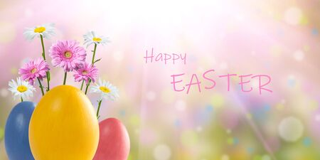 Easter colorful eggs and flowers, holiday background for your decoration. Egg hunt, copy space, Happy Easter lettering