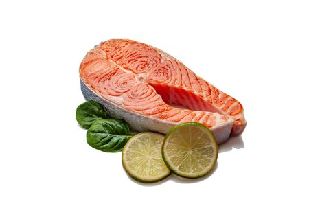 Fresh salmon fishes isolated on white background. Prepared to cooking, vegetables and fresh sea food