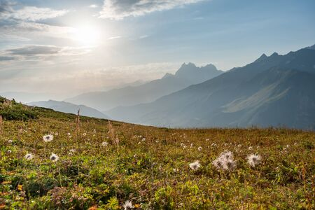 Beautiful landscape with sunset in mountains. Majestic peaks and sky. Enjoy travel adventure