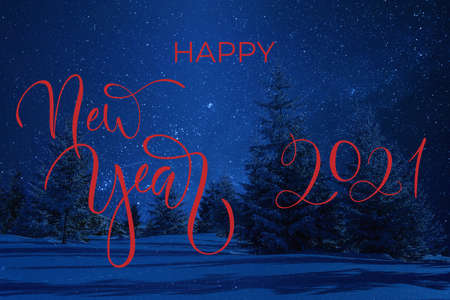 Night winter landscape with trees in snow and hand letterin text on greetings card. Stars in clear sky