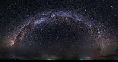Landscape night panorama with full Milky way over lowland Фото со стока